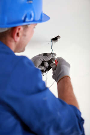 Electrician fixing electrical wiring photo