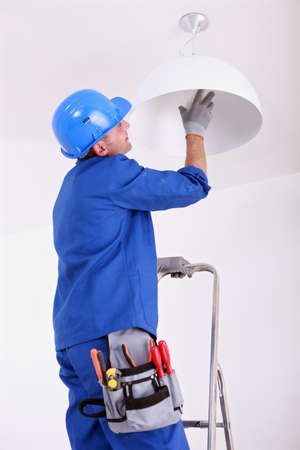 Electrician changing bulb photo