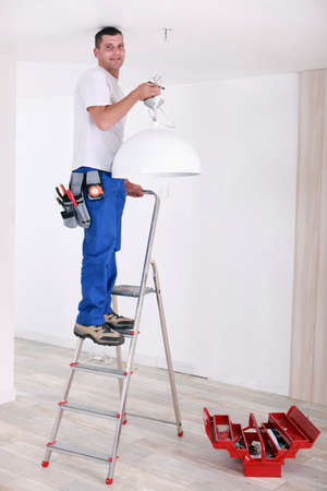 Handyman fixing lighting Stock Photo - 13782450