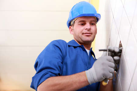 protrude: Worker cutting a wire Stock Photo