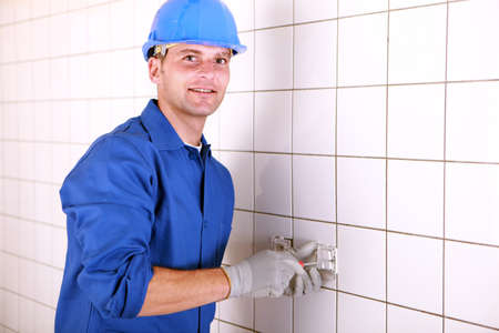 Electrician installing a socket photo