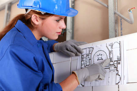 female engineer: Woman with electrical diagram