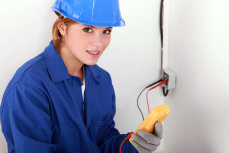 Woman using a multimeter photo