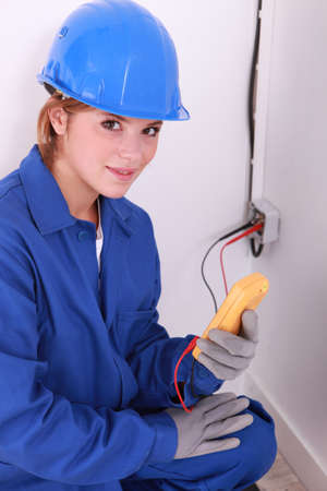 dow-eyed female electrician at work with tester Stock Photo - 13782923