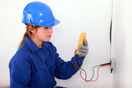 white glove test: Woman taking electrical reading