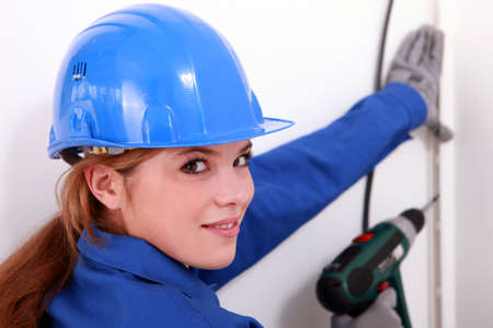 female artisan with a power drill Stock Photo - 13782784