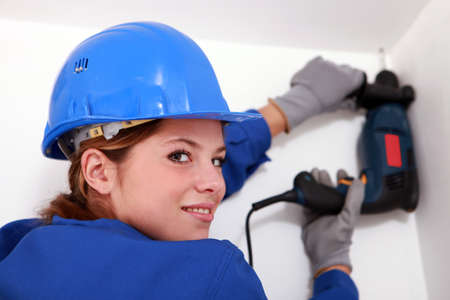 Woman with electric drill Stock Photo - 13782778