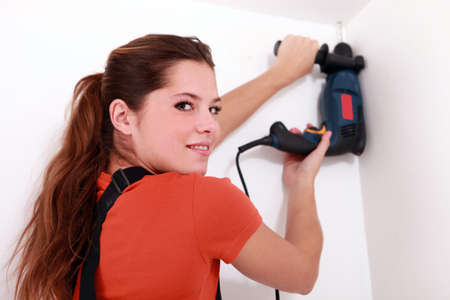 Woman with drill Stock Photo - 13782796