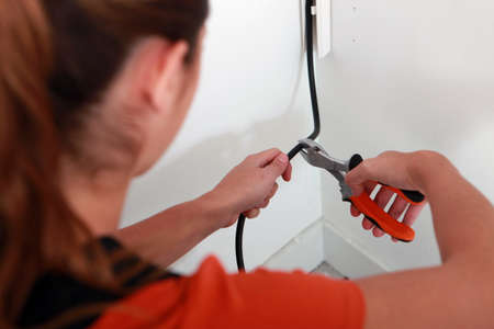 tradesperson: Electrician cutting a wire Stock Photo