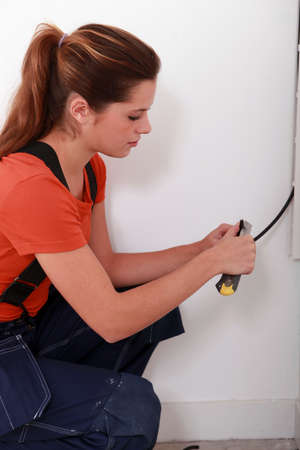 portrait of a female electrician photo