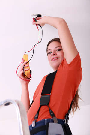 Woman with voltmeter Stock Photo - 13782412