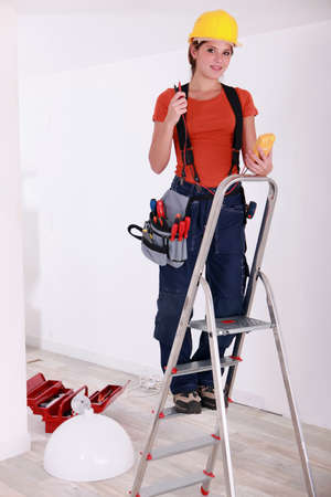 Female installing lamp photo