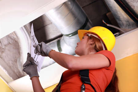air duct: Woman checking ventilation system