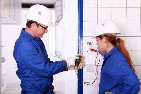 Electricians with voltmeter photo