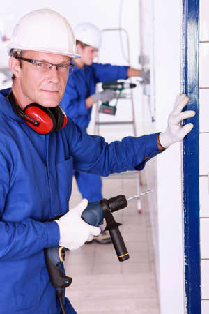 wireman: Man drilling