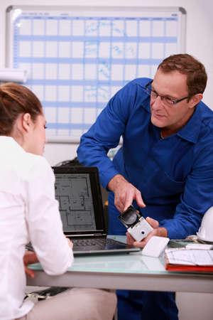 Technician explaining to assistant photo