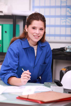 female in plumbing shop photo