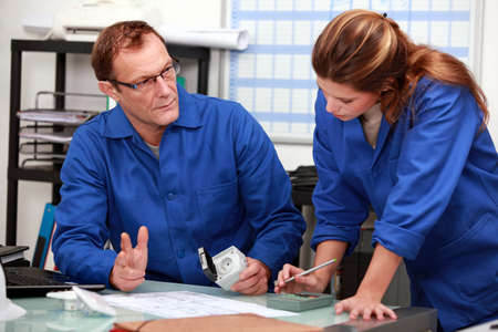 related: workers,  male, female, workplace Stock Photo