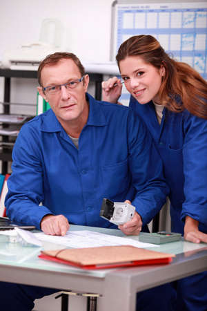 tradespeople: Tradespeople working together in the office Stock Photo