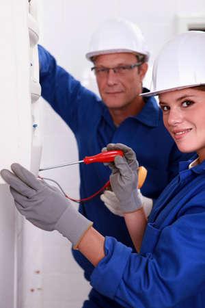 Workers undertaking repair work photo