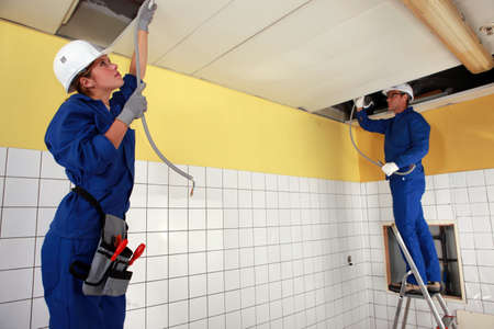 tradespeople: Tradespeople installing a heating system