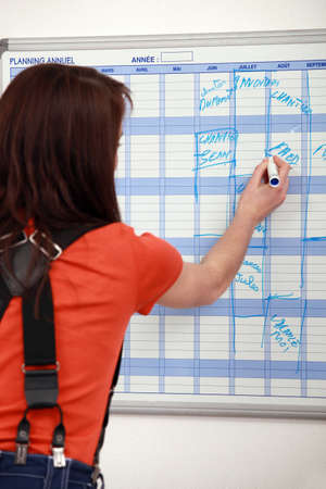 yourselfer: female apprentice noting down appointments