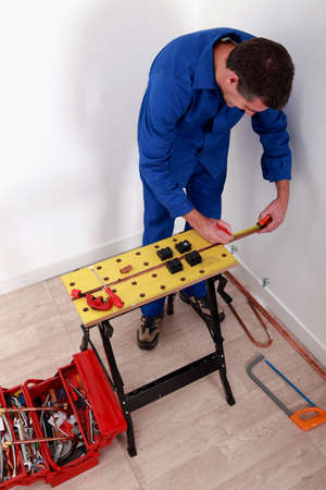 electrician fixing breaker box photo