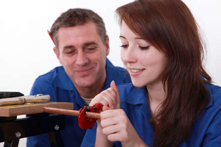 Young apprentice plumber with mentor Stock Photo - 13783151