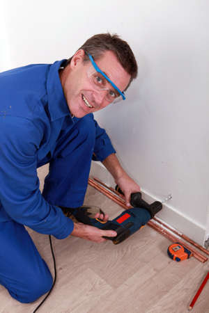 Artisan drilling wall Stock Photo - 13783239