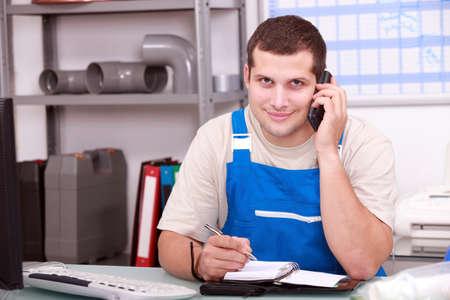 Plumbers merchant taking a phone call photo