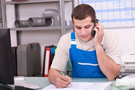 Craftsman in office  on phone Stock Photo - 13783150