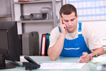 appoint: Man working in a plumbers office