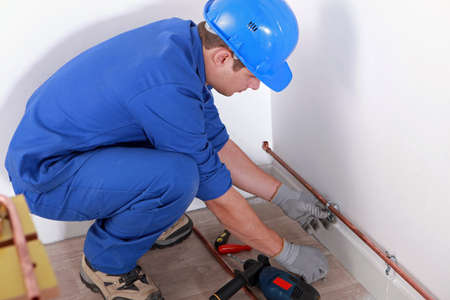 fitting: Plumber fitting pipes Stock Photo