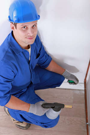 Plumber soldering pipe Stock Photo - 13783286
