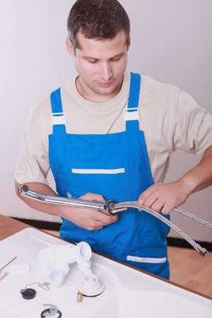 fixate: Plumber repairing a sink