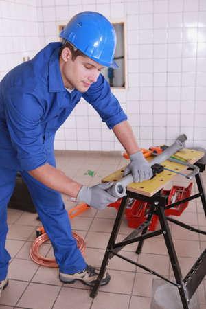 Plumber at work photo