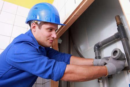 plumbing repair: Plumbers install drainage Stock Photo