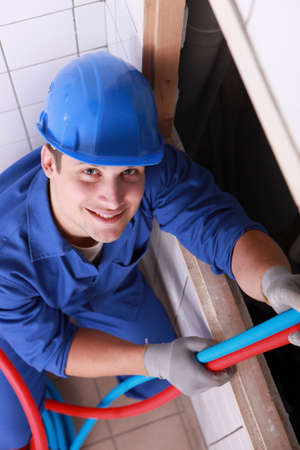 young plumber working photo