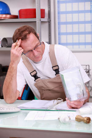 Reviewing Plumber reports Stock Photo - 13783759