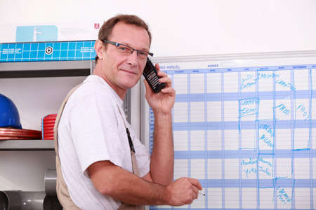 verifying: worker planning on a board Stock Photo