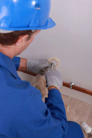 Tradesman making a loop Stock Photo - 13783778