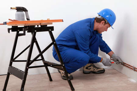 blowtorch: Laborer with screwdriver and blowtorch Stock Photo