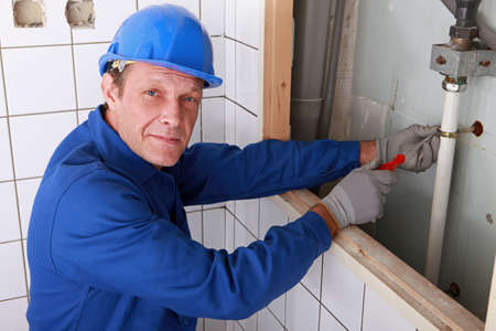 Plumber fixing water supply in bathroom Stock Photo - 13844357