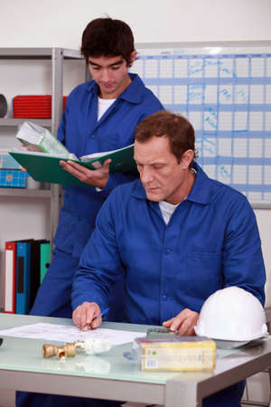 Manual workers in an office photo