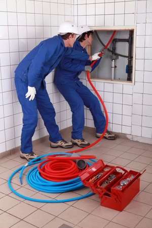 apprentice plumber training on-the-job photo