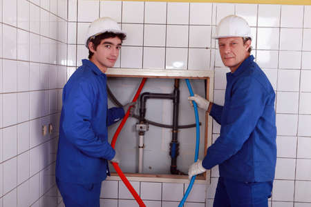 Team of plumbers Stock Photo - 13811666