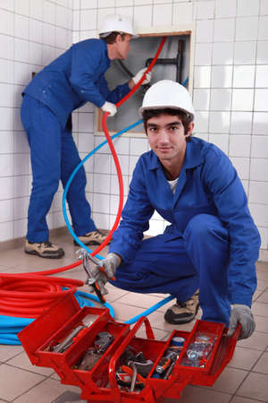Plumber and apprentice photo