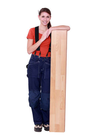jumpsuite: handywoman posing with a board