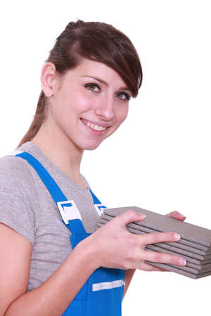 handywoman holding tiles Stock Photo - 13808312