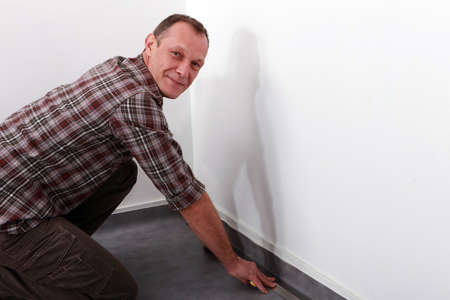 accommodate: craftsman changing the carpet Stock Photo